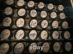 30 Autographed COA Hockey Puck With Display Case Ilitch-Yzerman 75th Anniversary