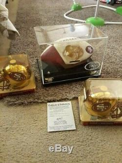Jerry Rice And Joe Montana Autographed Mini Helmets with COA and Display case