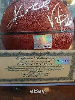 Kobe Bryant & Vince Carter Autographed Basketball With COA display cases included