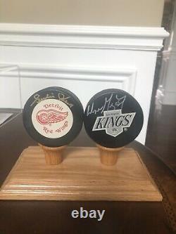 Wayne Gretzky and Gordie Howe Autographed Pucks, display case And COA